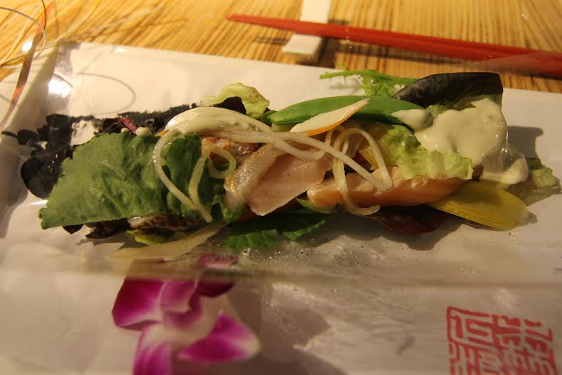 After unwrapping the salad, servers poured the Caesar dressing on the delicate salad.