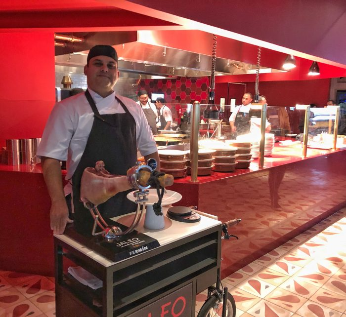 A Jaleo chef patiently waiting to carve Iberico ham tableside