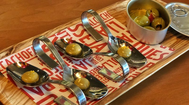 Olive plate with spherified liquid olives and anchovy/piquillo stuffed olives