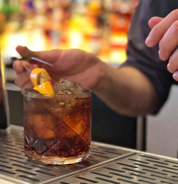 A Jaleo bartender prepares a glass of red vermouth