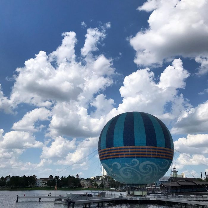 Cumulus try to build despite stubbornly dry air over Disney Springs during last week's heat streak.
