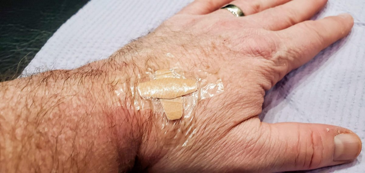 hand with bandaid