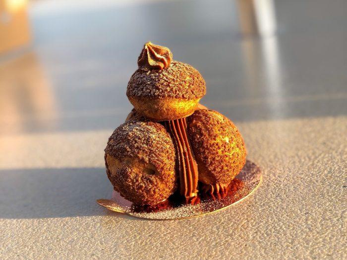 Hazelnut-Caramel Profiteroles at Le Petit Café Are Simply Divine
