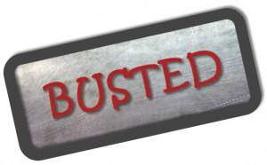 "Sign that reads ""Busted"""