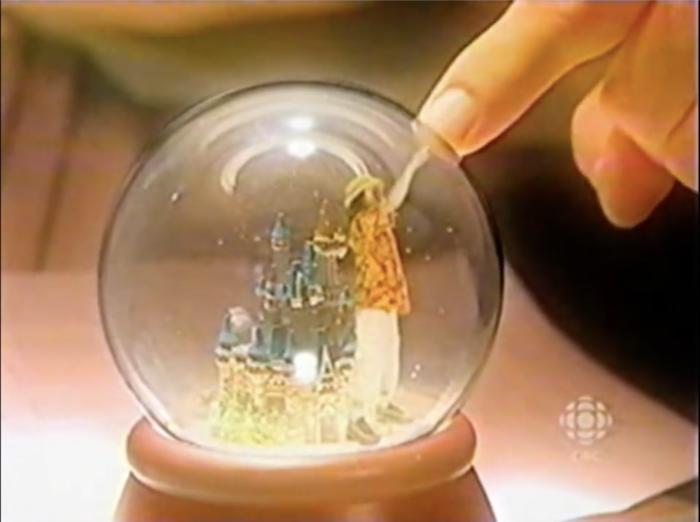 Colin touches the snow globe.
