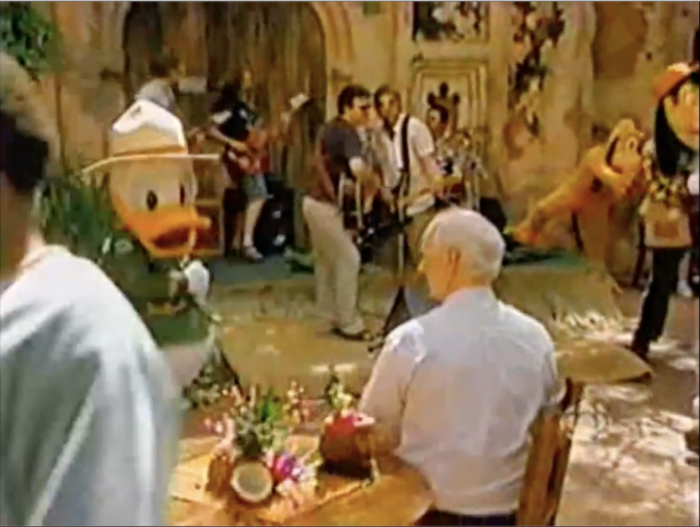 Colin sit ins Harambe in Animal Kingdom with a musical act and Donald Duck.