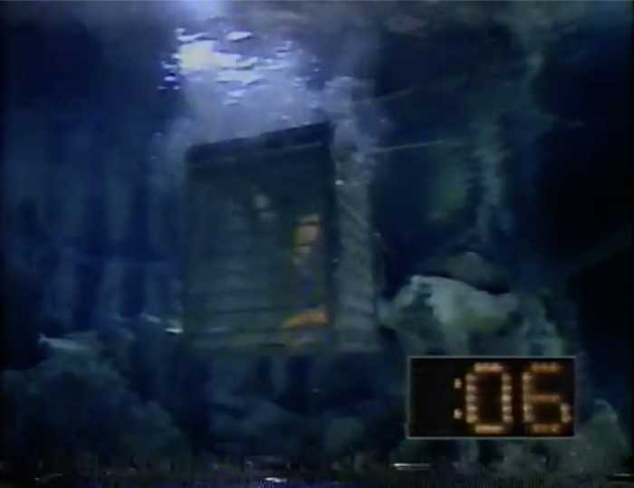 Cage is underwater with a timer showing 6 seconds.
