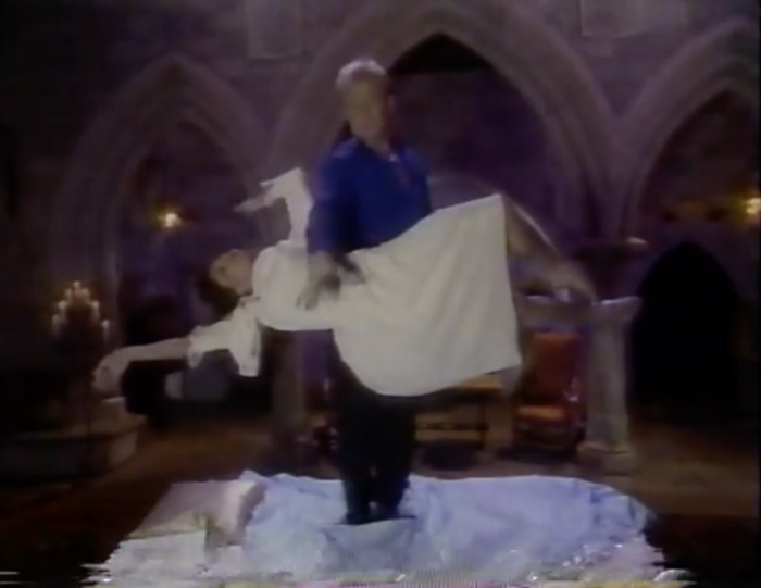The magical duo of the Pendragons are performing a levitating lady trick behind Sleeping Beauty's castle.