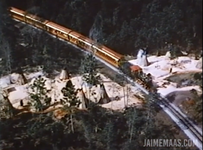 Overhead view of the Magic Kingdom train traveling through a Native American village.