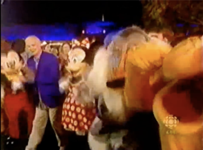 Colin dances with Disney characters.