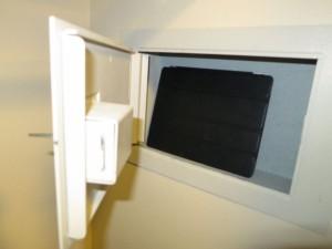 Pop Century safe holding iPad.