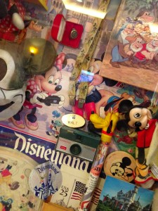 A tiny selection from the massive case of tags, trinkets, and photos in the Convention Center at Disneyland Hotel.