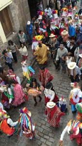 Small Christmas morning street parade in Cusco.