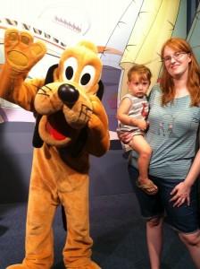 toddler at epcot meets Pluto