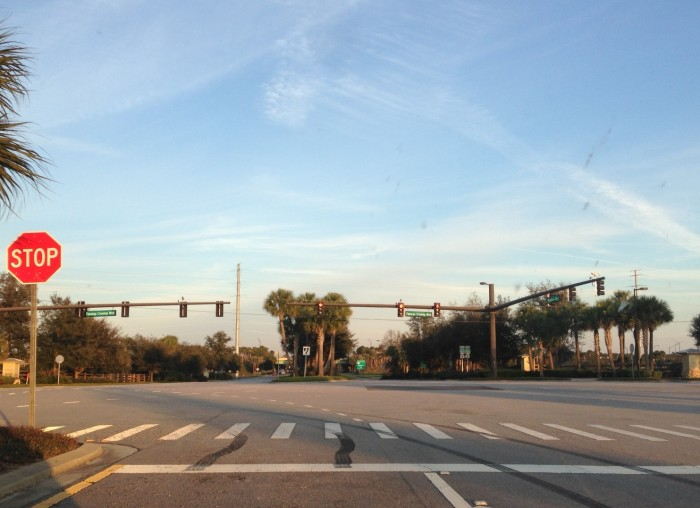 The intersection of Flamingo Crossings Boulevard and Western Way currently is a four-way stop with next to no traffic, but traffic lights, multiple lanes, and designated crosswalks predict more activity in the future. (Photo by Julia Mascardo)