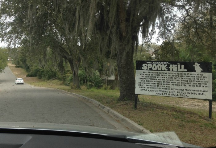 Pulling up to Spook Hill. The car ahead is at the white line where you'll park for your own experience.