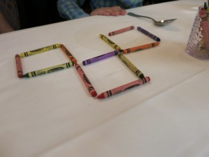 Servers often entertain kids at dinner with simple magic tricks or puzzles using tabletop objects