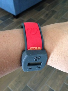 This is how you actually have to place it--on one side or the other, but not covering the Mickey on your MagicBand. (Photo by Julia Mascardo)