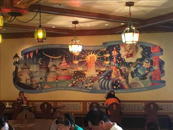Pleasure Island mural and candy-themed lights in Pinocchio Village Kitchen