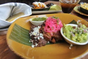 Carnitas entree at Frontera Cocina, with pickled onions, tomatillo sauce, and guacamole