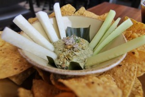 Frontera Cocina's sikil pak dip, made with pumpkin seeds and served with cucumber and jicama sticks