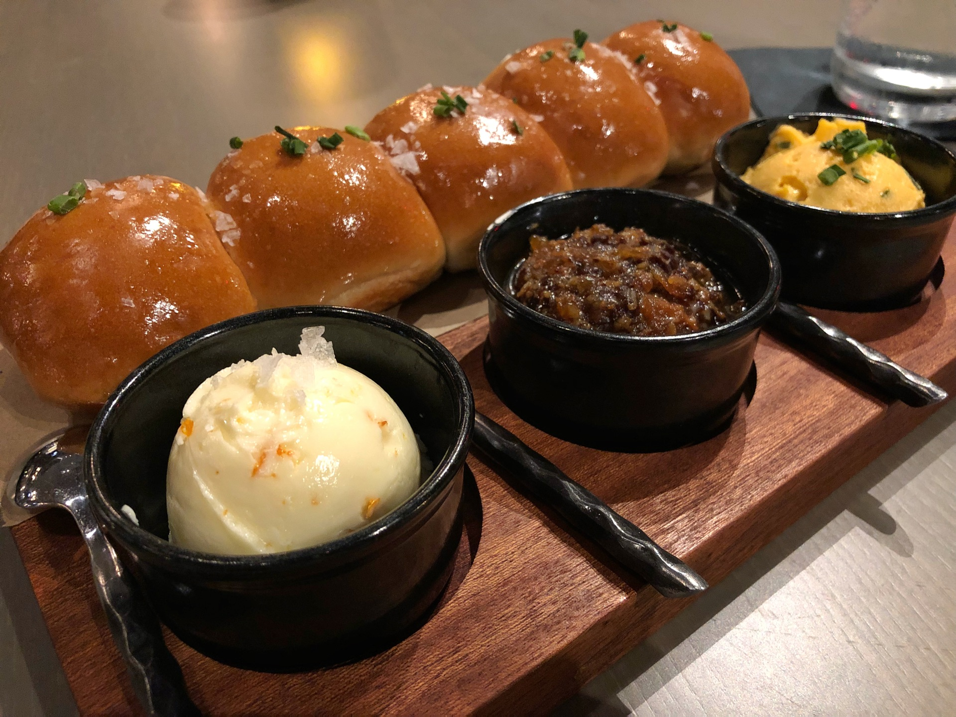 Parkerhouse rolls with citrus butter, bacon jam, and pub cheese