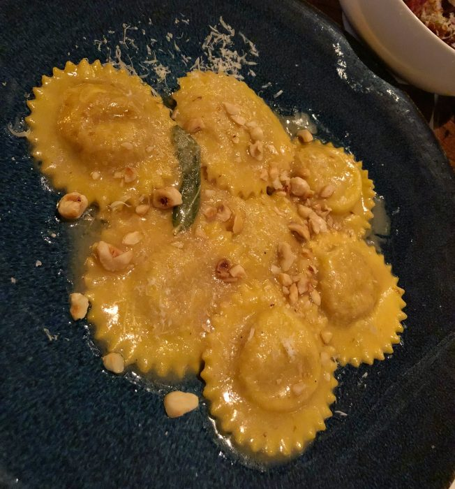 Pumpkin ravioli with hazelnuts, brown butter, and sage